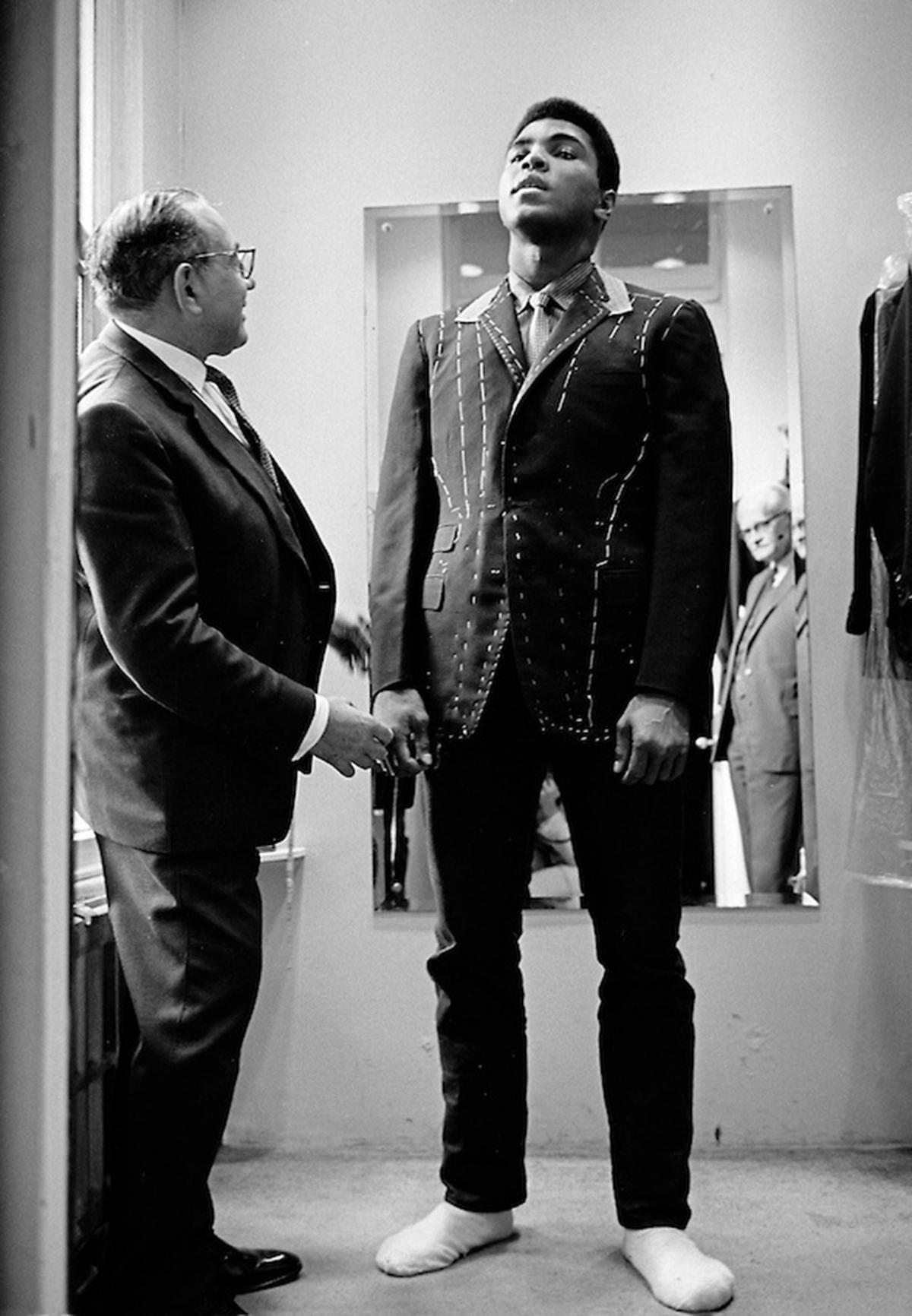 01 Muhammad Ali is measured for a bespoke suit by a tailor in londonÔÇÖs Savile Row, 1966 ÔÇó Thomas Hoepker
